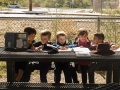 The first grade students from Julian Barcelo's class write in their journals about the plants they planted and observed inside Davis Bilingual Magnet School garden in Tucson, Ariz. on Wednesday, Feb. 25, 2015. Photographed by Noelle Haro-Gomez