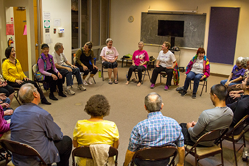 The class of Laughter Yoga sit in a circle to start a laughter exercise that will promote happiness and peace in Tucson, Ariz. at St. Francis in the Foothills on Tuesday, Feb. 2, 2015. Students do not use yoga matts for the class. Photographed by Noelle Haro-Gomez
