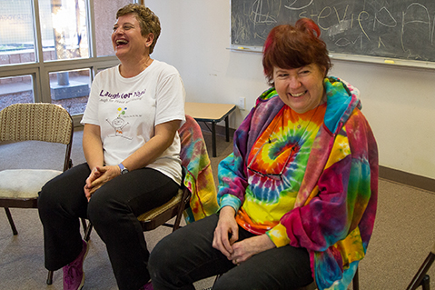 Jana Martin, left, and Loti Gest, certified Laughter Yoga Leaders, share a moment together before class begins at Laughter Yoga in Tucson, Arizona on Tuesday, Feb. 17, 2015. Martin and Gest have never missed teaching a Tuesday class. Photographed by Noelle Haro-Gomez