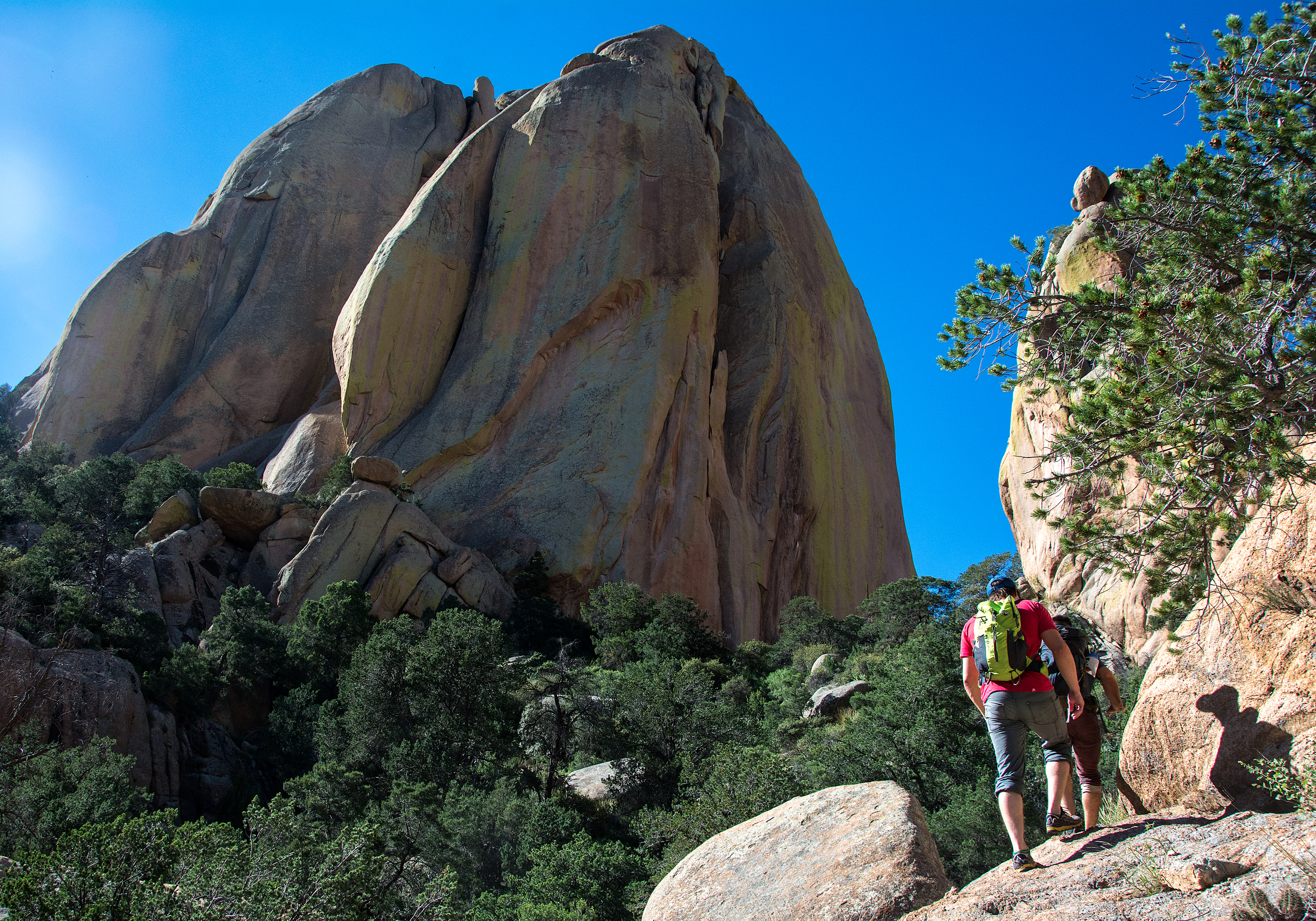 Austin Sobotka leads Jesse Johnston on the final stretch of the approach to the Rockfellows on the east side of the Cochise Stronghold outside of Pearce, Ariz. on Sunday, Sept. 4, 2016. The Rockfellow group is widely considered the premiere climbing destination in Cochise and most prominently includes End Pinnacle, Chey Desa Tsay and Rockfellow Dome. (Alex McIntyre / Arizona Sonora News Service)