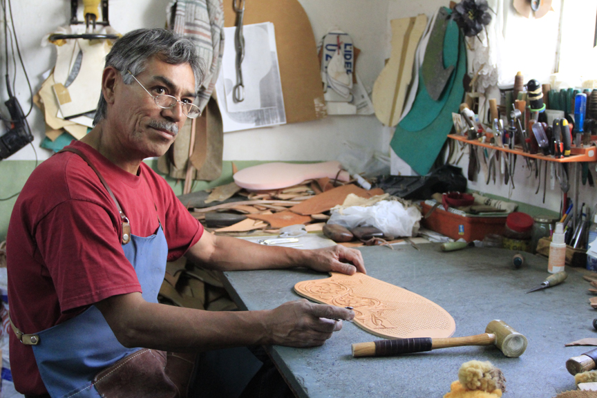 One of the craftsmen at Talabartería Rancho Grande in Magdalena, Sonora, works on cowhide that ultimately will become part of a custom saddle. (Photo by Samantha Sais/ASNS)