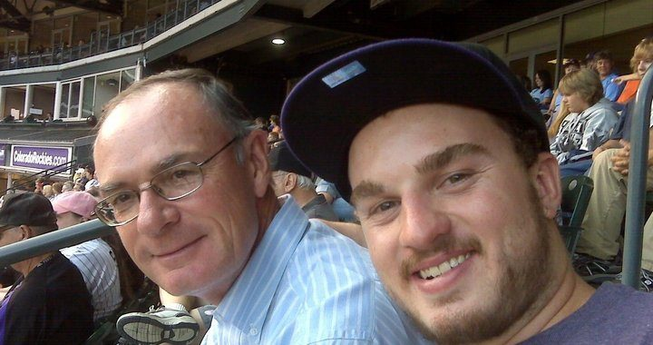 Tom Rice, left, and his son Jon, right attend a Colorado Rockies baseball game from their club-level seats at Coors Field.