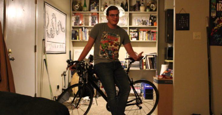Christian Matthews, 24, sits on his custom-built bicycle.