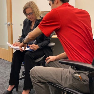 Dr. Barton discusses research projects with research specialist Ricky Cordova on Oct. 21, 2019. (Photo by Dominika Heusinkveld).