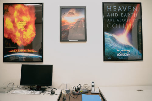 A room inside the Sky Survey's offices is covered in movie posters and other art that picture a massive meteor destroying Earth.