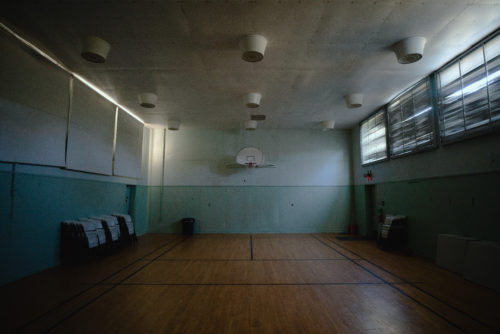In addition to the common and living areas in the former military barracks, there was also a basketball court for soldiers to use in their downtime on the mountaintop. The station was operational from 1956 to 1969.