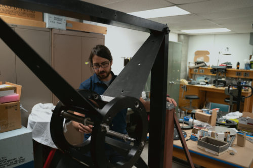 Fuls inspects a new mount that will be used for a telescope camera that he and another astronomer, Steve Larson, are renovating.
