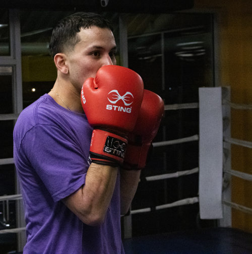 Jaime Cuesta, a young amateur boxer, gets ready to start his night training for an upcoming tournament. Cuesta spends around 4-6 hours a day practicing his boxing. (Photo by Madeleine Viceconte)