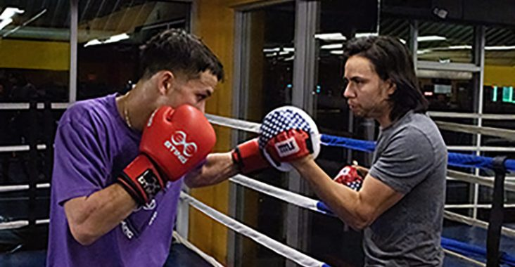 Cuesta hits mitts with his coach, Chris Gonzalez, during a training session. Gonzalez helps Cuesta stay motivated for fights and also admires his drive and ambition. (Photo by Madeleine Viceconte)